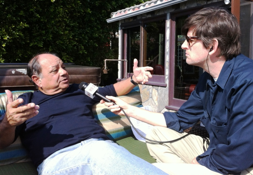 Cheech Marin (left) with Off-Ramp host John Rabe, talking about Chicano art at Marin's Malibu Cheech house.
