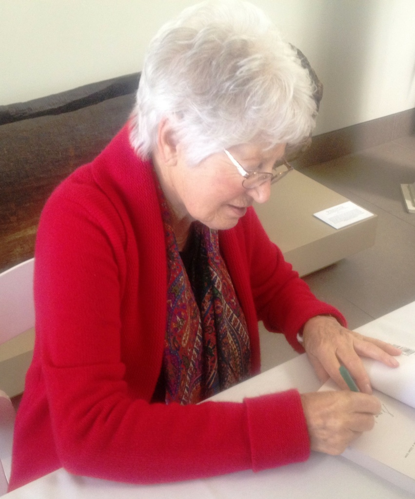 Schindler Jew Laura Hillman signing books at the Bowers Museum.