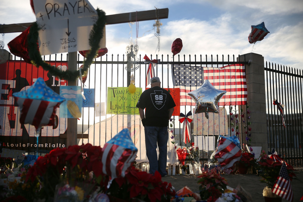 David Santos visits a make shift memorial for those killed and injured setup near the Inland Regional Center on December 7, 2015 in San Bernardino, California. 14 people died and another 17 were injured on December 2, 2015 in a mass shooting.