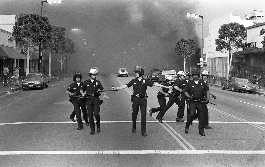 One of a series of photographs taken by photographer Gary Leonard and his fourteen-year-old son, David Leonard, during the Los Angeles Riots, 1992.
