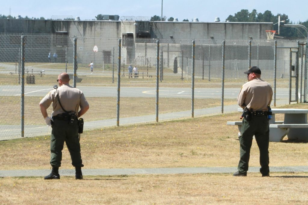 In this Aug. 17, 2011 file photo,  correctional officers keep watch on inmates on the recreation yard at Pelican Bay State Prison near Crescent City, Calif.