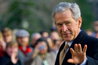 File Photo: Former U.S. President George W. Bush waves as he walks into the White House Jan 8, 2009, on his way to the Oval Office.