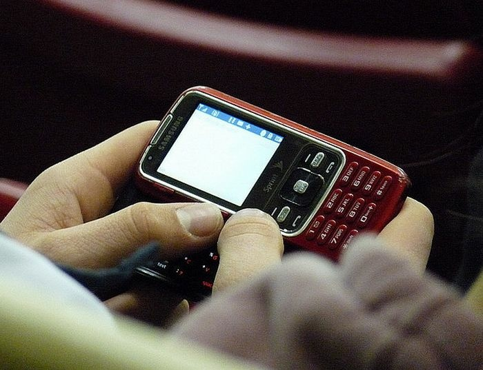 A cellphone user texts on a Samsung phone.