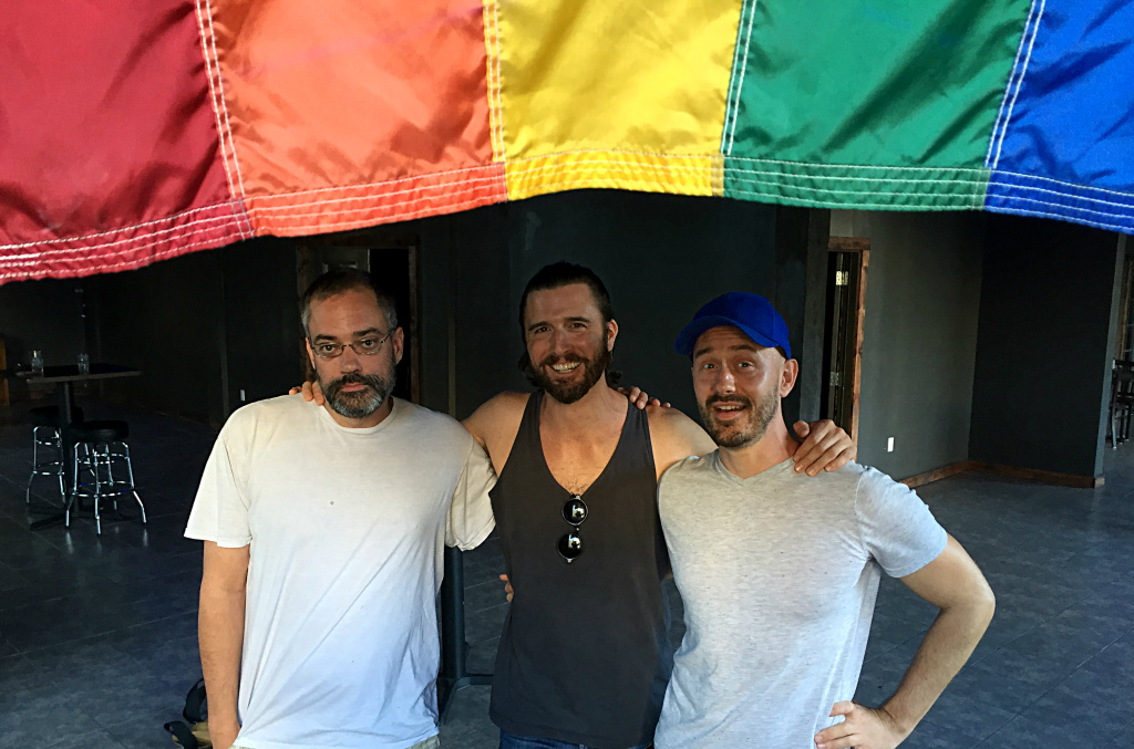 L-R Thor Stephens, co-owner of Precinct; Garrett Mckechnie, co-owner of Bar Mattachine; and Drew Mackie, writer for Frontiers magazine. They're at Precinct, one of several gay bars to open in LA recently.