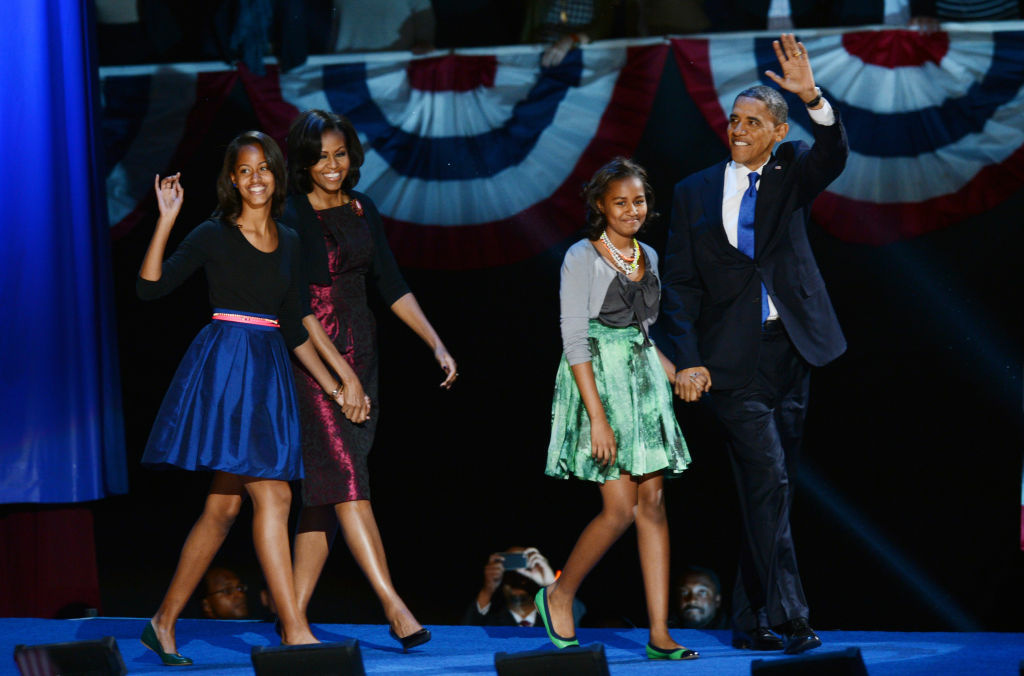 US President Barack Obama and family arrive on stage after winning the 2012 US presidential election November 7, 2012 in Chicago, Illinois. Obama swept to re-election, forging history again by defying the dragging economic recovery and high unemployment which haunted his first term to beat Republican Mitt Romney.