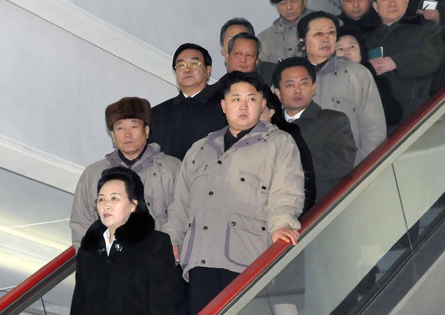 In this undated file photo released by the Korean Central News Agency and distributed by the Korea News Service on Dec. 17, 2011, North Korean leader Kim Jong Il's son, Kim Jong Un, second row right, rides on an escalator with his aunt Kim Kyong Hui, bottom, her husband Jang Song Thaek, second man behind Kim Jong Un, and others when they visit a Pyongyang supermarket with his father. During a Workers' Party conference Wednesday, April 11, 2012 in Pyongyang, Kim Jong Un was named first secretary of the party, a post that is newly created and that analysts believe is now the top Workers' Party job. Kim Kyong Hui, 66, the younger sister of late leader Kim, was named a secretary of the party's Central Committee while Soviet-trained technocrat Jang, 66, a vice chairman of the powerful National Defense Commission, was named a member of the Political Bureau. v