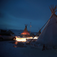 Activists at Oceti Sakowin near the Standing Rock Sioux Reservation brace for sub-zero temperatures expected overnight on December 6, 2016 outside Cannon Ball, North Dakota.