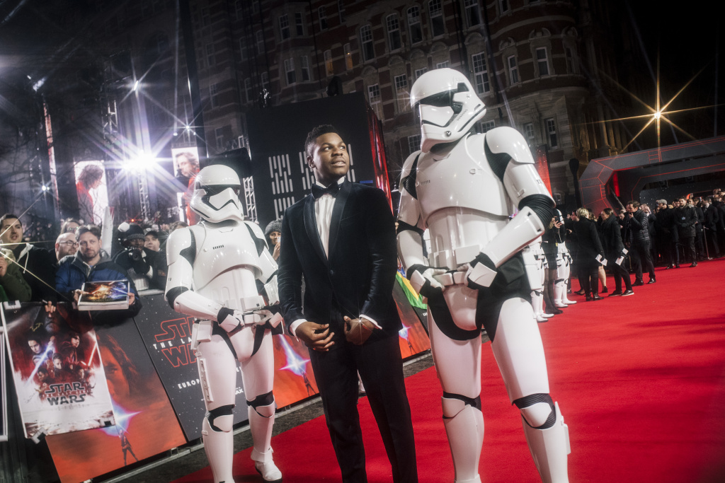 LONDON, ENGLAND - DECEMBER 12:  (EDITORS NOTE:  This image was created using a starburst filter.) John Boyega attends the European Premiere of Star Wars: The Last Jedi at the Royal Albert Hall on December 12, 2017 in London, England.  (Photo by Gareth Cattermole/Getty Images for Disney)