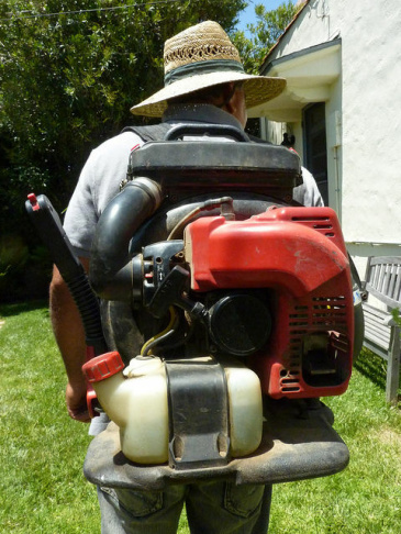 Gardener Martin Gutierres shows off his leaf blower's 2-stroke engine.