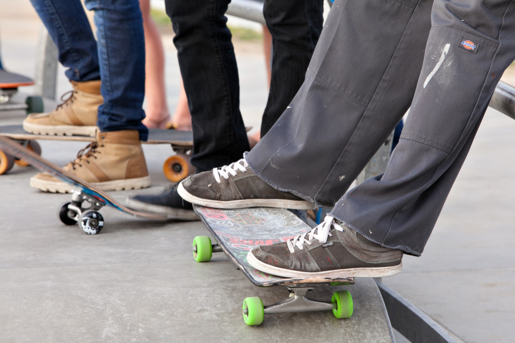 Skaters wait around the fences at a skate park in Venice Beach.