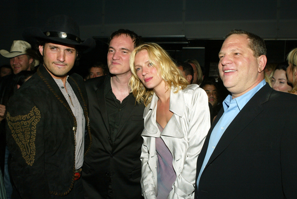 From left to right: director Robert Rodriguez, director Quentin Tarantino, actress Uma Thurman and Miramax producer Harvey Weinstein talk at the after-party for