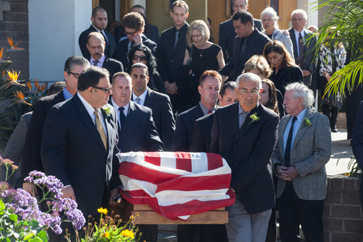 Pallbearers bring the casket of Joseph Gatto down the steps of Our Mother of Good Counsel Church in Los Feliz on November 25th. Gatto was shot dead in his Silver Lake home. The murderer has not been found.