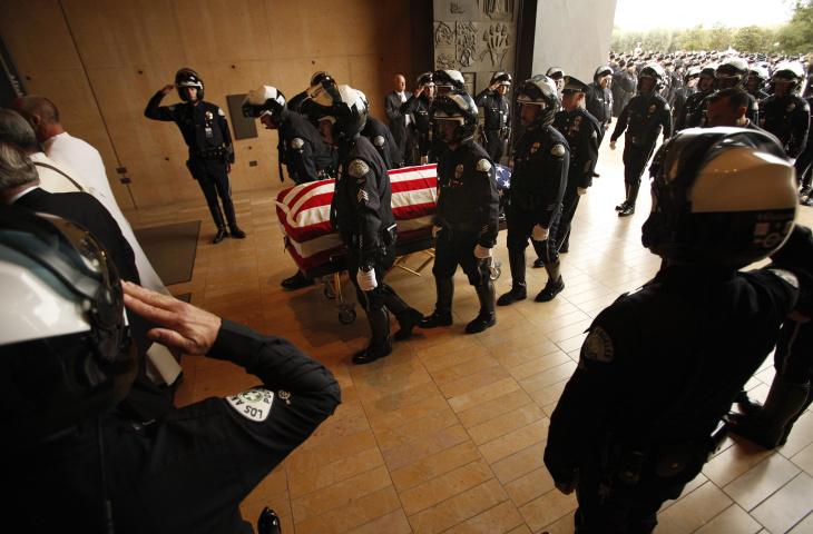 LOS ANGELES, CA  - APRIL 22:  Pallbearers escort the coffin of Los Angeles Police Dept. (LAPD) motor officer Chris Cortijo into the Cathedral of Our Lady of the Angels April 22, 2014 in Los Angeles, California. Cortijo, a LAPD member for nearly 27 years, died four days after he was struck by an allegedly impaired driver in a Chevrolet Blazer on April 5, while stopped at a red light on Saticoy Street and Lankershim Boulevard in Sun Valley.  (Photo by Al Seib-Pool/Getty Images)