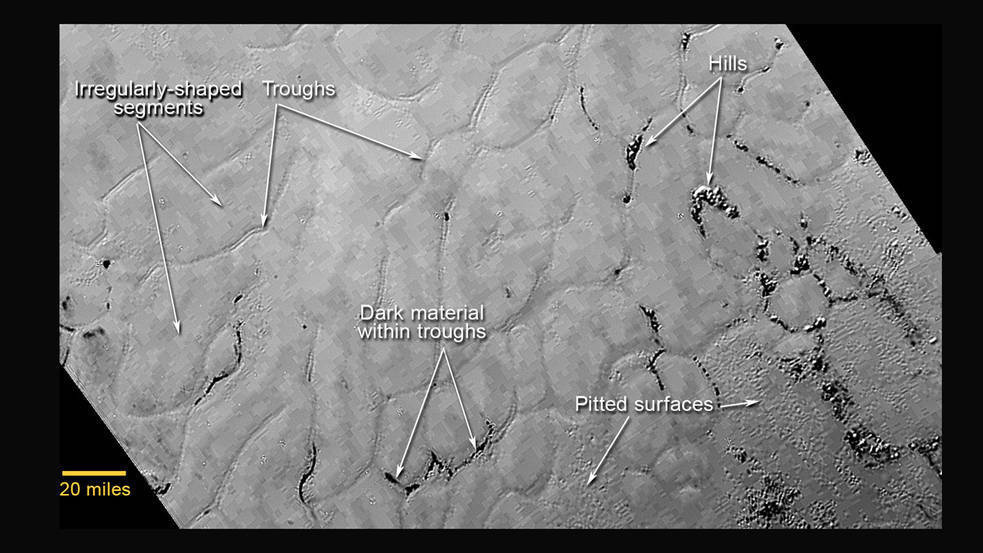 In the center left of Pluto's vast heart-shaped feature – informally named