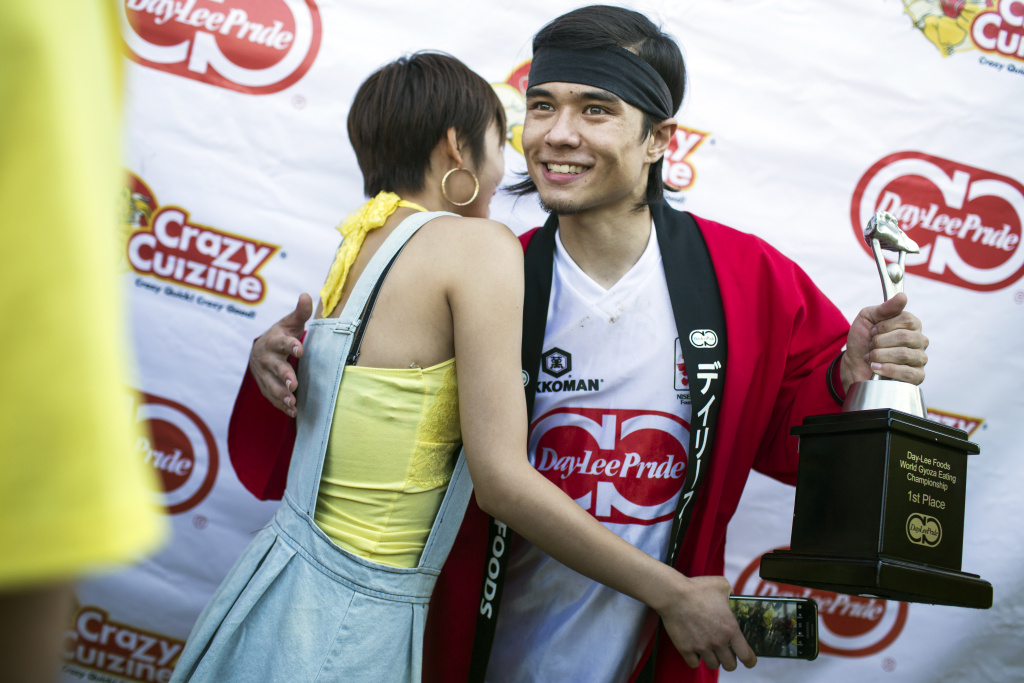 Competitive eater Matt Stonie takes pictures with fans after his first place win at the 2016 World Gyoza Eating Championship at the Japanese American Cultural and Community Center on Saturday, Aug. 20, 2016.