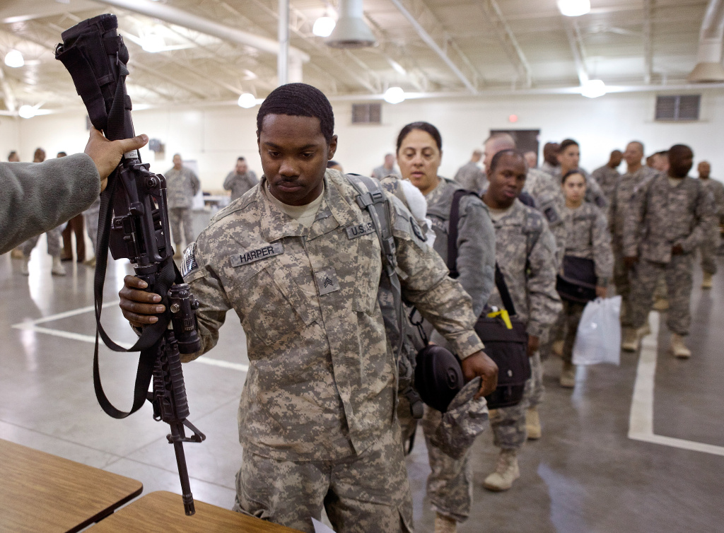 Soldiers turn in their weapons to Joint Base Lewis-McChord, Washington.