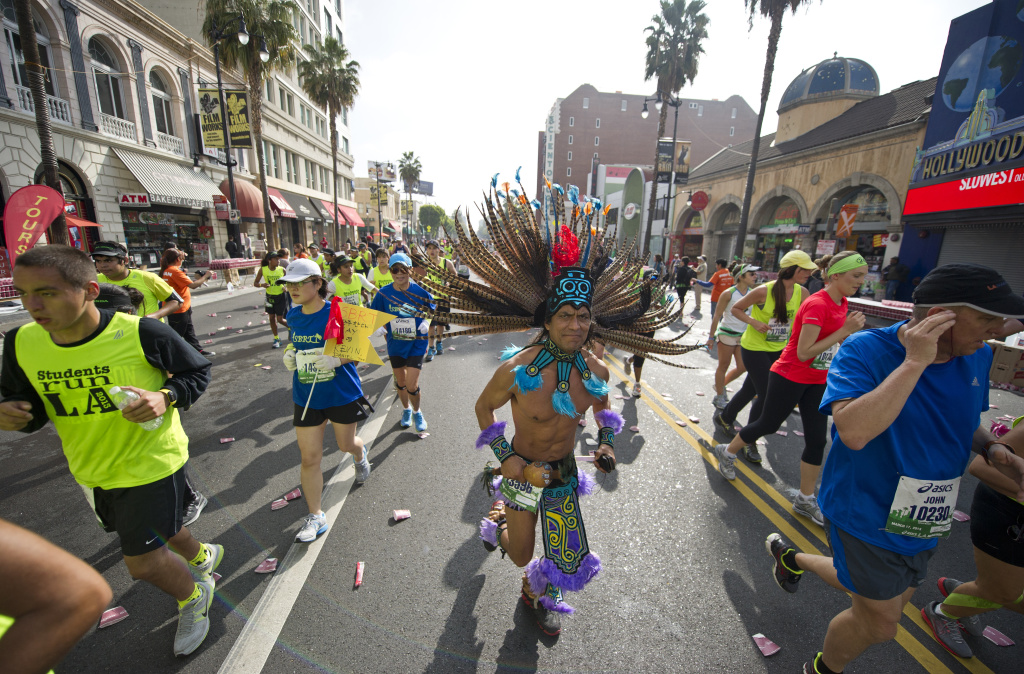 Thousands of participants run down Hollywood boulevard during the annual L.A. Marathon on March 17, 2013 in Hollywood, California. The marathon started at Dodger Stadium and finished at the Santa Monica Pier.