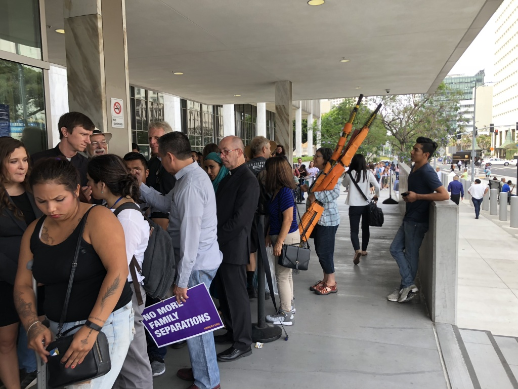 A line of supporters of a Guatemalan father facing deportation wait to enter the ICE building in downtown Los Angeles on July 10, 2018.