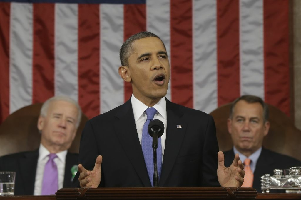 President Barack Obama, flanked by Vice President Joe Biden and House Speaker John Boehner of Ohio, gestures during the State of the Union address before a joint session of Congress on Capitol Hill in Washington, Tuesday Feb. 12, 2013.