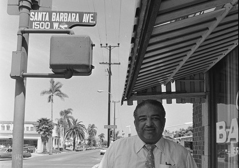 Celes King III poses in front of his bail bonds business on the corner of Denker Av and, what was then, Santa Barbara Av. He worked to rename Santa Barbara Av into Martin Luther King Blvd in 1983.