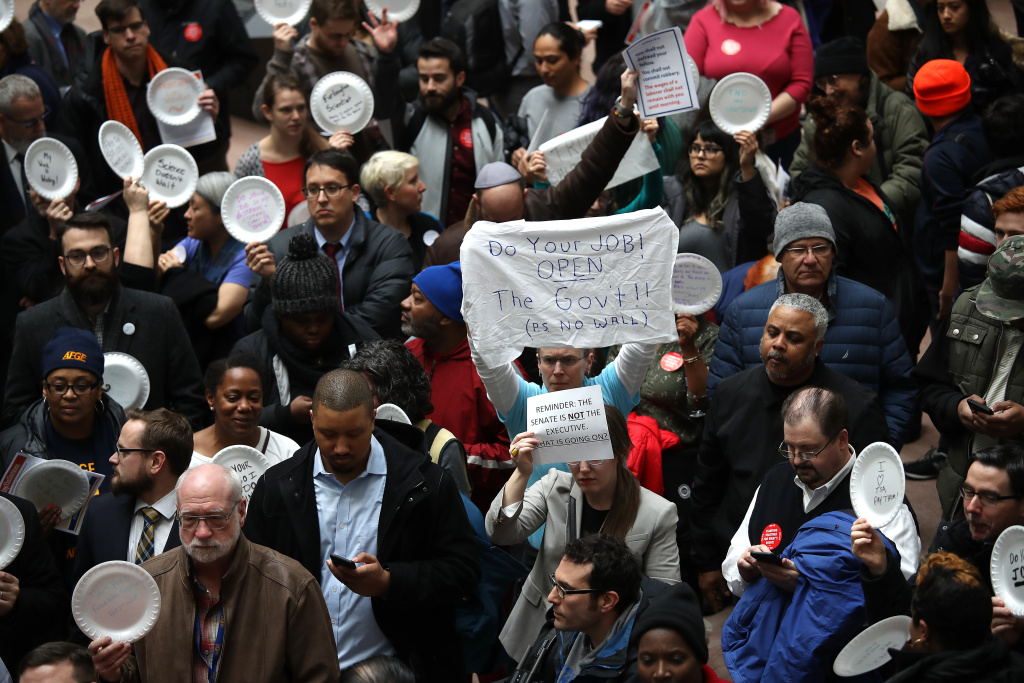 Furloughed federal workers and those aligned with them protest the partial government shutdown in the Hart Senate Office Building January 23, 2019 in Washington, DC.