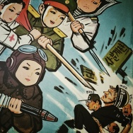 Painted Propaganda, showing North Korean children in armed services uniforms attacking U.S., Japanese and South Korean soldiers, hangs in a room inside a Pyongyang kindergarten. (AP Photo/David Guttenfelder)