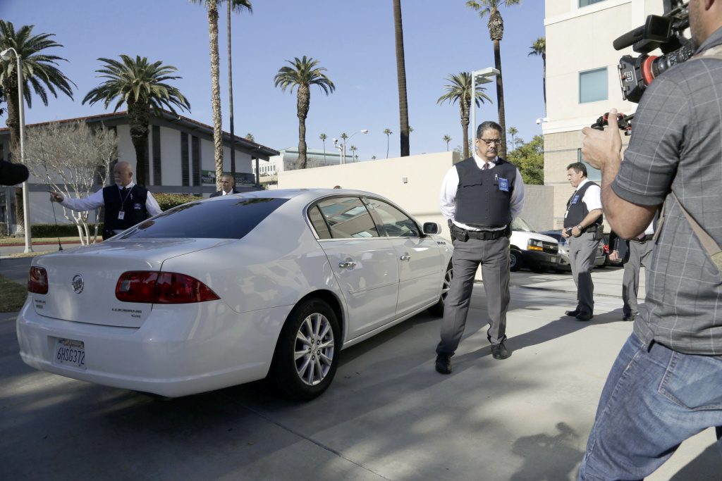 Security is tight as a car carrying Enrique Marquez Jr. arrives at U.S. District Court in Riverside, Calif., Thursday, Dec. 17, 2015. Marquez, a longtime friend of Syed Rizwan Farook, the male shooter in the San Bernardino terrorist attack, was charged today with conspiring with Farook in 2011 and 2012 to commit crimes of terrorism, and with the unlawful purchase of two assault rifles used in the deadly shooting two weeks ago.