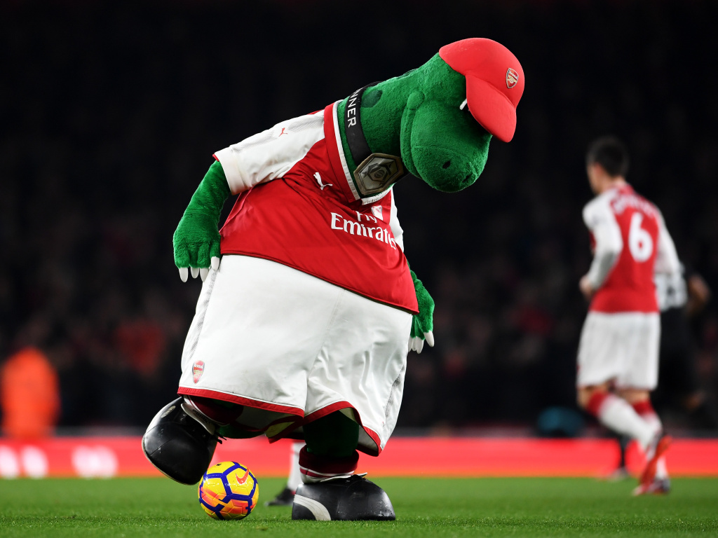 Gunnersaurus is seen warming up prior to a match at Emirates Stadium in 2017 in London. Jerry Quy, who played the team's mascot Gunnersaurus for 27 years, was recently told he would be let go.