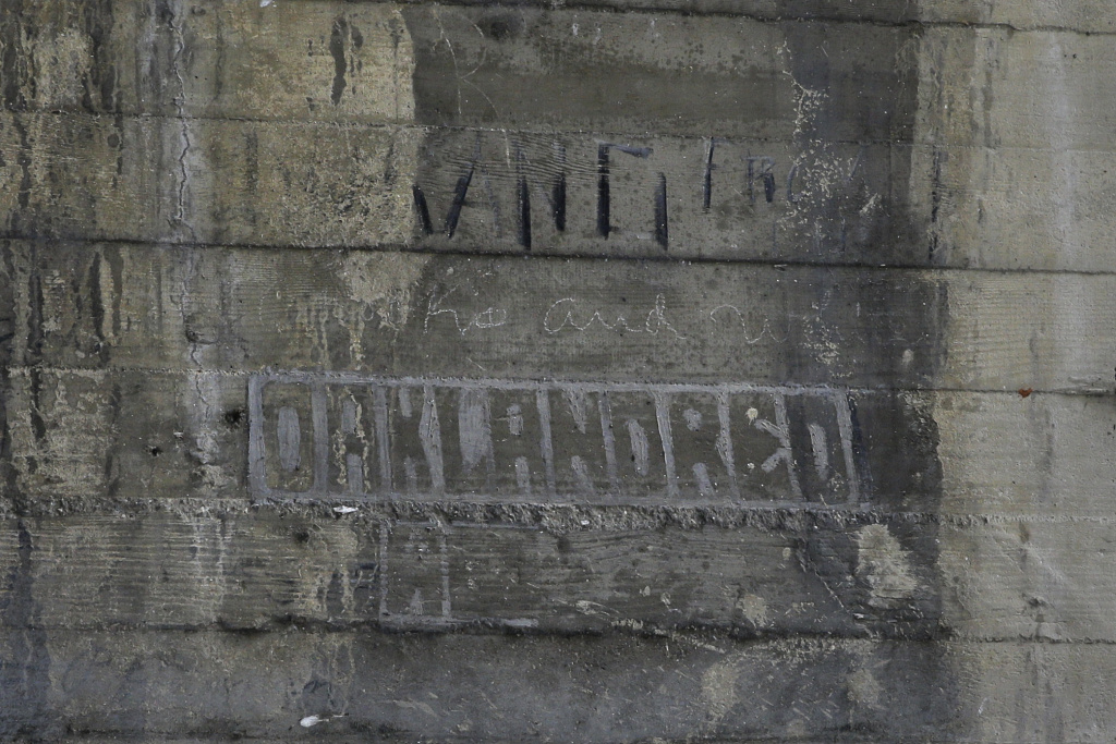 Graffiti left by hobos are seen under a bridge in Los Angeles. The writings and drawings, some dating to 1914, were written with utensils such as grease pencils or etched into the concrete under the103-year-old bridge spanning the Los Angeles River.