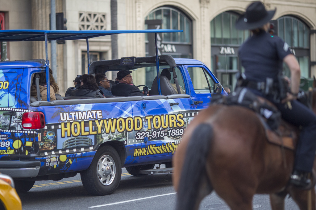 Tourists ride a tour bus on Hollywood Boulevard on Dec. 6, 2016.