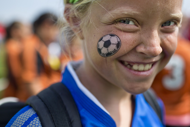 Ten-year-old Maci Spencer of Weston, Florida wears a soccer ball temporary tattoo.