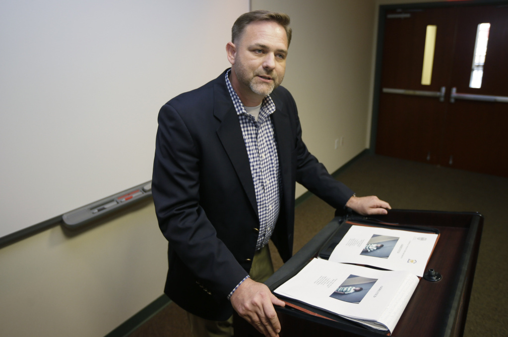Prosecutor Cody Hiland speaks at a news conference in Conway, Ark., on Aug. 7, after two teenagers were charged in the murders of Robert and Patricia Cogdell. On Wednesday, the FBI agreed to help the Faulkner County prosecutor get access to an iPhone and iPod that belonged to the suspects.