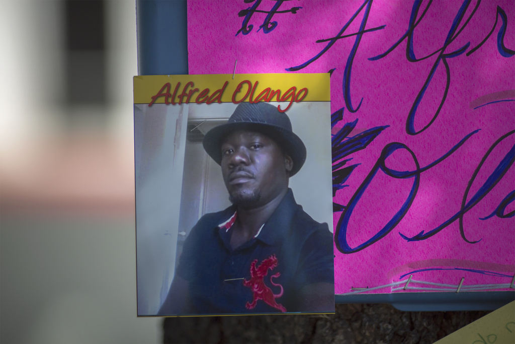 File: A photo of Alfred Olango, 38, hangs at a makeshift memorial at the site where he was shot by police earlier this week on September 29, 2016 in El Cajon, California.