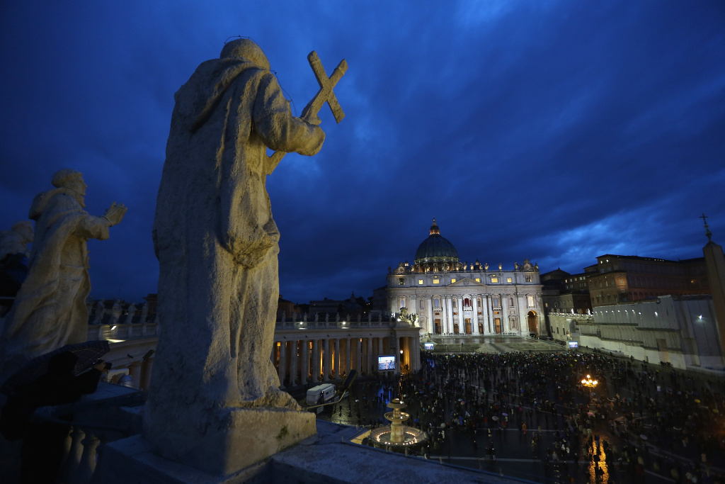 People gather in St Peter's Square as Cardinals meet in the Sistine Chapel for the 1st day of the conclave on March 12, 2013 in Vatican City, Vatican.