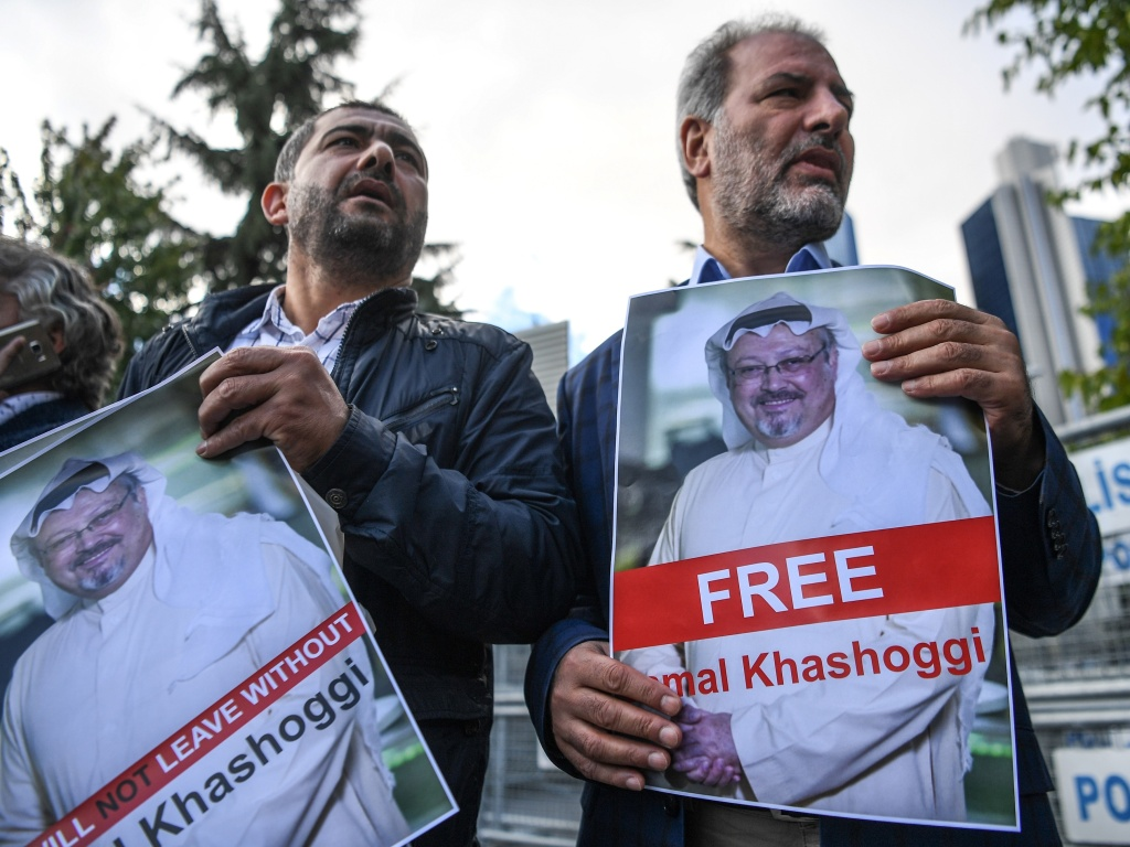 Protestors hold pictures of missing journalist Jamal Khashoggi during a demonstration in front of the Saudi Arabian consulate, on Friday in Istanbul.