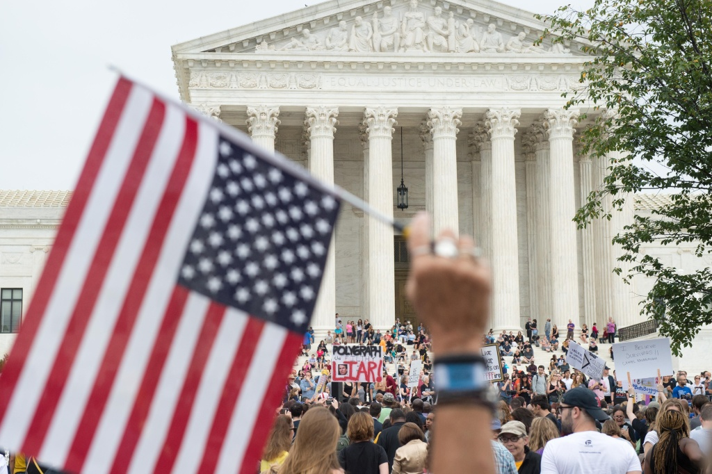 Demonstrators protest against the appointment of Supreme Court nominee Brett Kavanaugh at the Supreme Court in Washington DC, on October 6, 2018.