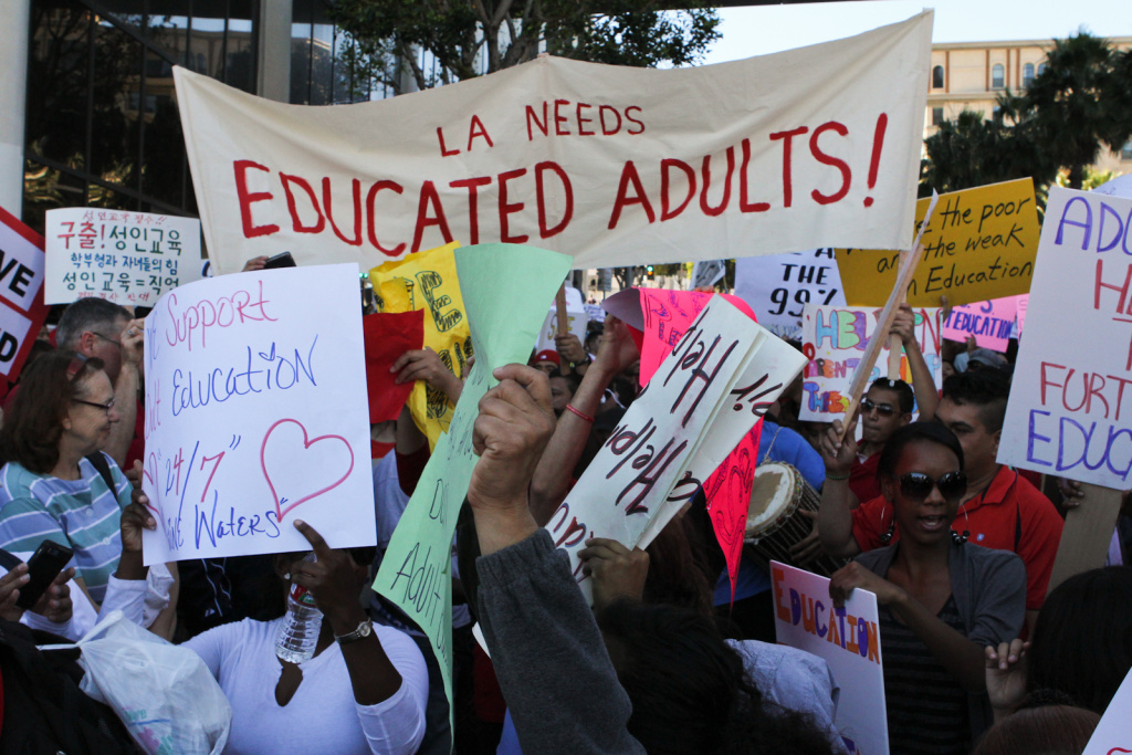 Adult education supporters hoisted signs outside school district headquarters in downtown Los Angeles.