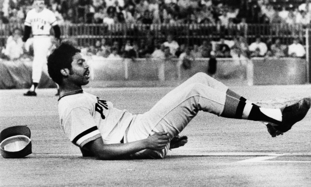 Pittsburgh Pirates Pitcher Dock Ellis is on the ground as he watches his throw go wild to Bob Robertson at first in 6th inning of Pirates vs. Philadelphia Phillies game Wednesday, Sept. 11, 1974 in Philadelphia, Pa.