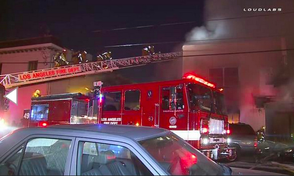 A man was killed and 11 other people were hospitalized after a suspected arson fire at a motel in Wilmington early Thursday, authorities said.