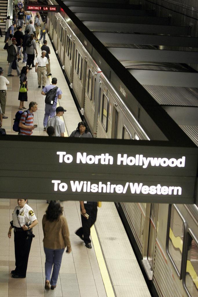 Commuters board a train in Los Angeles