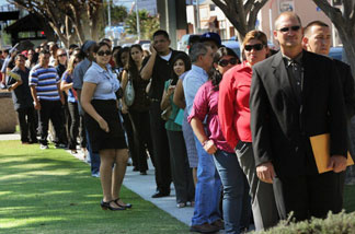 Unemployed Americans line up to enter a job fair on the first day of the Labor Day long weekend in the City of El Monte outside of Los Angeles on September 4, 2010. US unemployment jumped to 9.6 percent in August, the Labor Department said, showing the recovering economy is still struggling to create jobs.