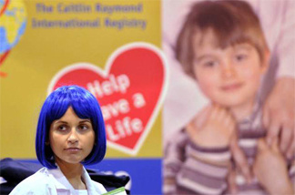Natasha Smahlei, a model, works at the Caitlin Raymond International Registry exhibit in October during the New England Business Expo at the DCU Center in Worcester.