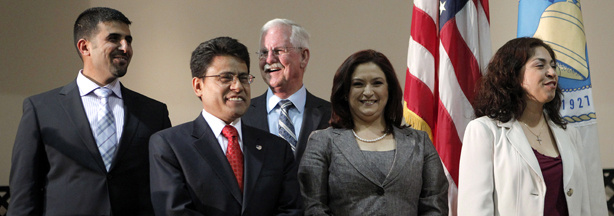 Newly elected city council members Ali Saleh, from left, Nestor Enrique Valencia, Danny Harber, Violeta Alvarez and Ana Maria Quintana take part during a swearing-in ceremony in Bell, Calif. Thursday, April 7, 2011.