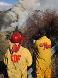 Firefighters for Cal Fire watch for hot spots.