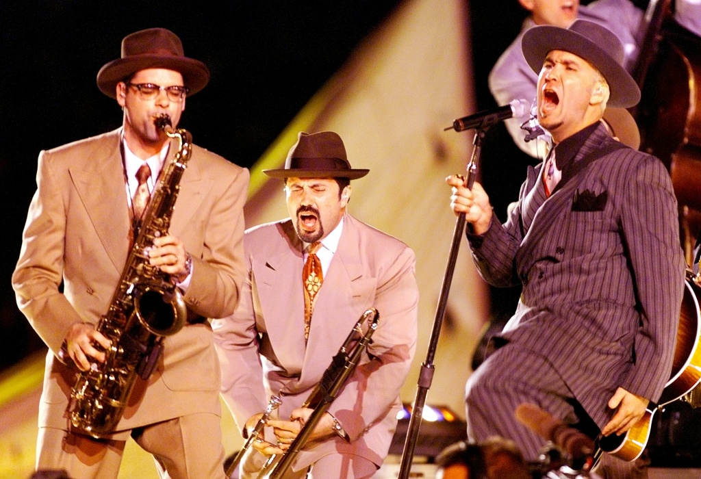Swing band Big Bad Voodoo Daddy performs during the halftime show at Super Bowl XXXIII on January 31 at Pro Player Stadium in Miami, Florida.