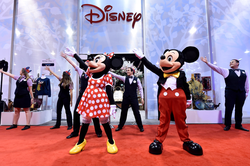 IMAGE DISTRIBUTED FOR DISNEY STORE - Disney Store at D23 Expo officially opens with a little help from Mickie Mouse and Minnie Mouse on Friday, August 14, 2015 in Anaheim, Calif. (Photo by Jordan Strauss/Invision for Disney Store/AP Images)