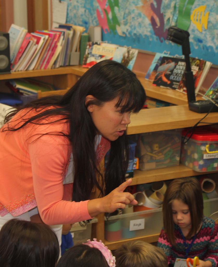 Kindergarten teacher, Sharon Lee, with her new students at Carlthorp School in Santa Monica.