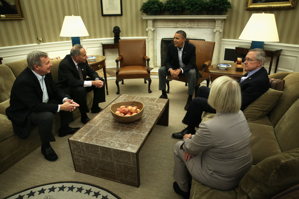 President Barack Obama meets with Senate Democratic leaders to discuss the government shutdown and the nation's debt ceiling in the White House's Oval Office, Oct. 12, 2013. Obama said in a media interview that he'll make a renewed push for immigration reform once the nation's fiscal crisis is resolved.
