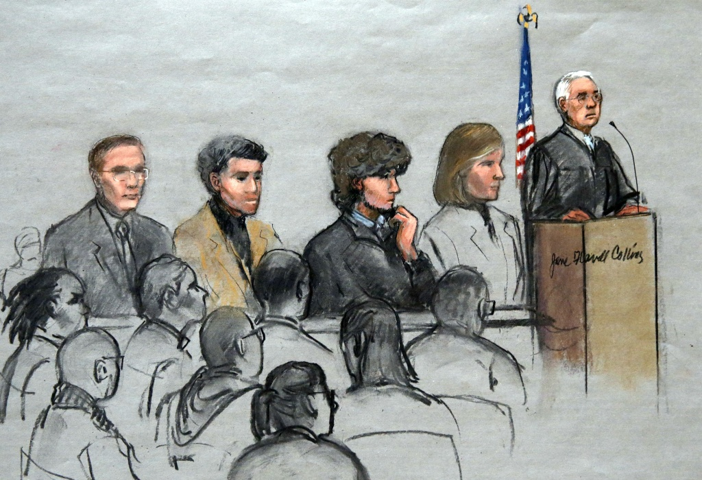 File: In this courtroom sketch, Boston Marathon bombing suspect Dzhokhar Tsarnaev, third from right, is depicted with his lawyers and U.S. District Judge George O'Toole Jr., right, as O'Toole addresses a pool of potential jurors in a jury assembly room at the federal courthouse, Tuesday, Jan. 6, 2015, in Boston. Tsarnaev went on trial for his life Wednesday in the Boston Marathon bombing with his own lawyer bluntly telling the jury he did it.