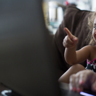Three-year-old Reagan Hurtado watches a preschool course with her mother on a laptop in their Monrovia home on Friday, July 18.